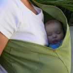 Baby in sling type baby carrier