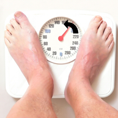 Man on Bathroom Scales