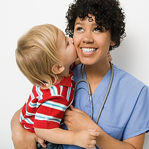Boy Kising Nurse at Check-In for Checkups: Bringing Health Care to Underserved Children