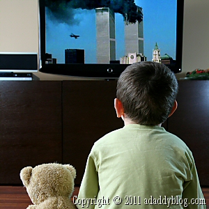 Child watching 9-11 anniversary news coverage