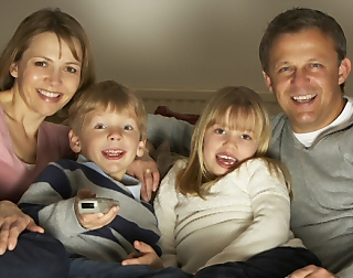 Family watching DirecTV's dish network together