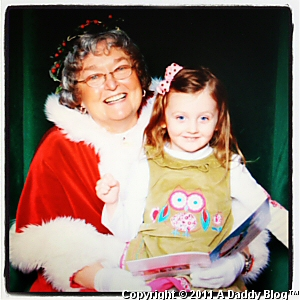 My Daughter at Parks Mall with Mrs Claus 2011 (Santa scared her)