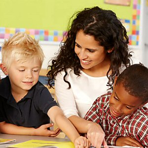 Teacher with Students - Public Schools, Private Schools or Homeschooling?