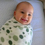 Happy Swaddled Baby - How and why to swaddle your infant