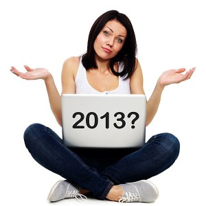 Woman with laptop, wondering when are the 2013 holidays?