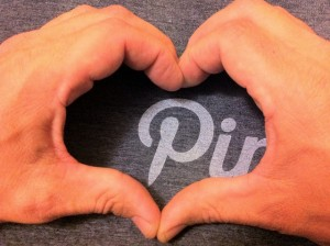 Hands in the shape of a heart aroiund the pinterest logo