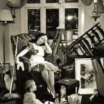 Vintage photo of an exhasted mother and child in a cluttered room