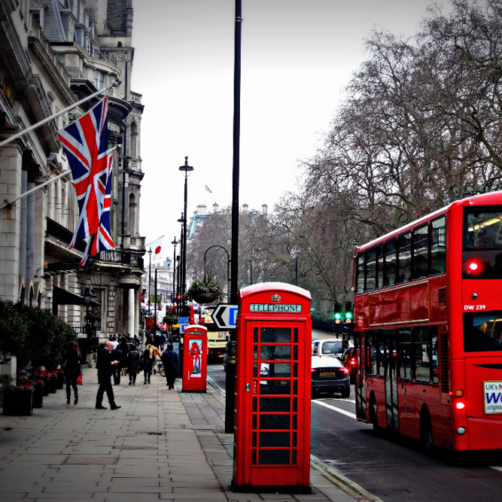 London street with phone booth and double decker bus
