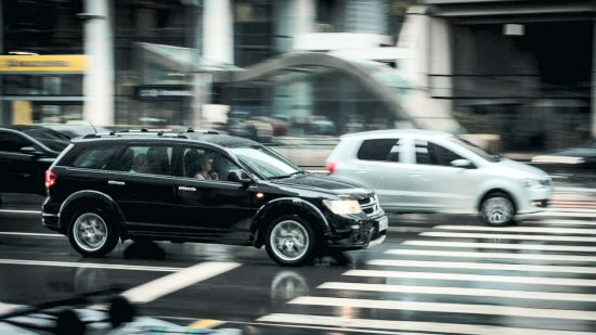 black-suv-beside-grey-auv-crossing-the-pedestrian-line-during-daytime